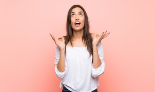 Young woman over isolated pink background frustrated by a bad situation